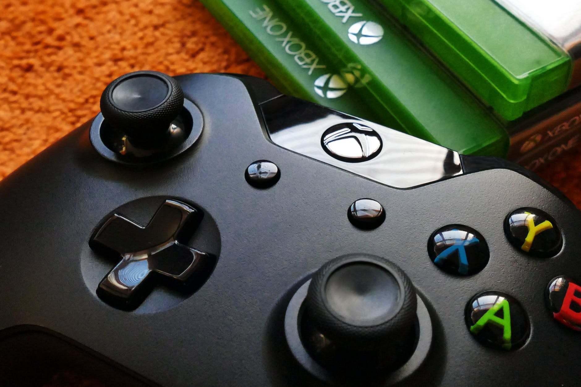 xbox one controller beside three xbox one cases